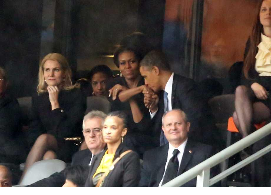 obama flirting mandela President obama seemed to be enjoying himself much too much -- seated next to denmark's attractive blonde prime minister at the nelson mandela memorial tues.
