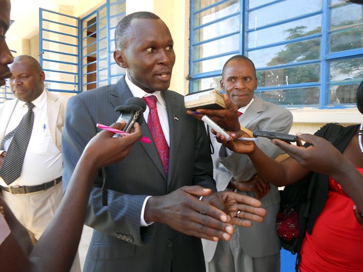 Dr Arthur Sserwanga being interviewed by press.