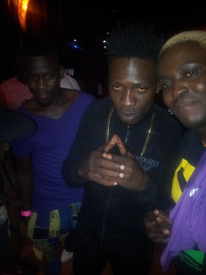 The ghetto gladiator's [Bobi Wine] look at the Purple Party event,