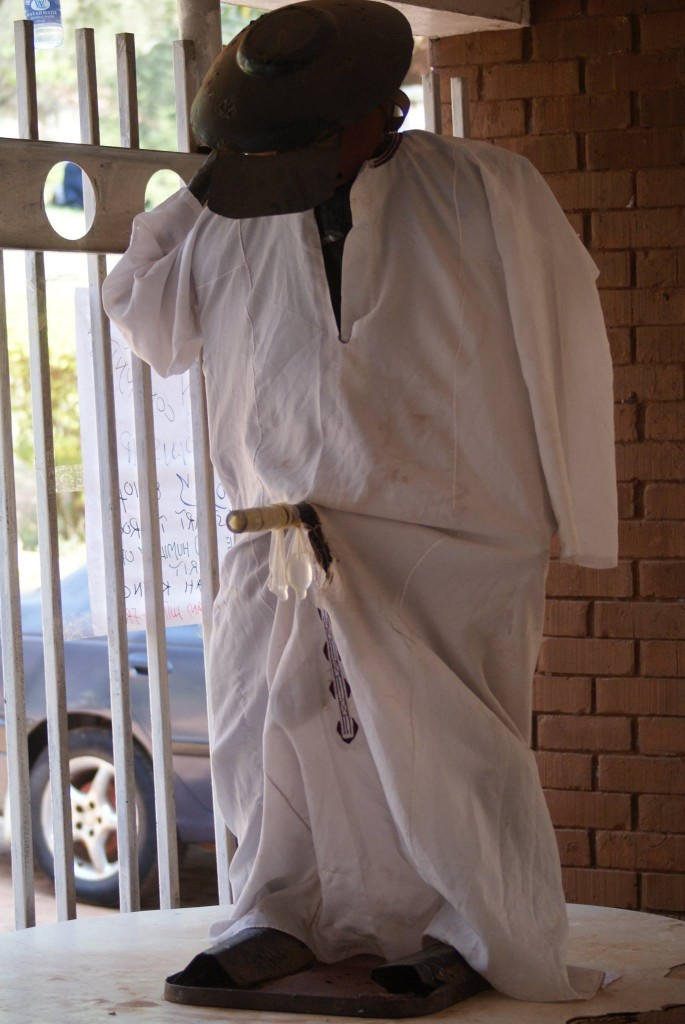 The Gongom Statue attired in a Kanzu and a condom. PHOTOGRAPHY BY Badru Katumba
