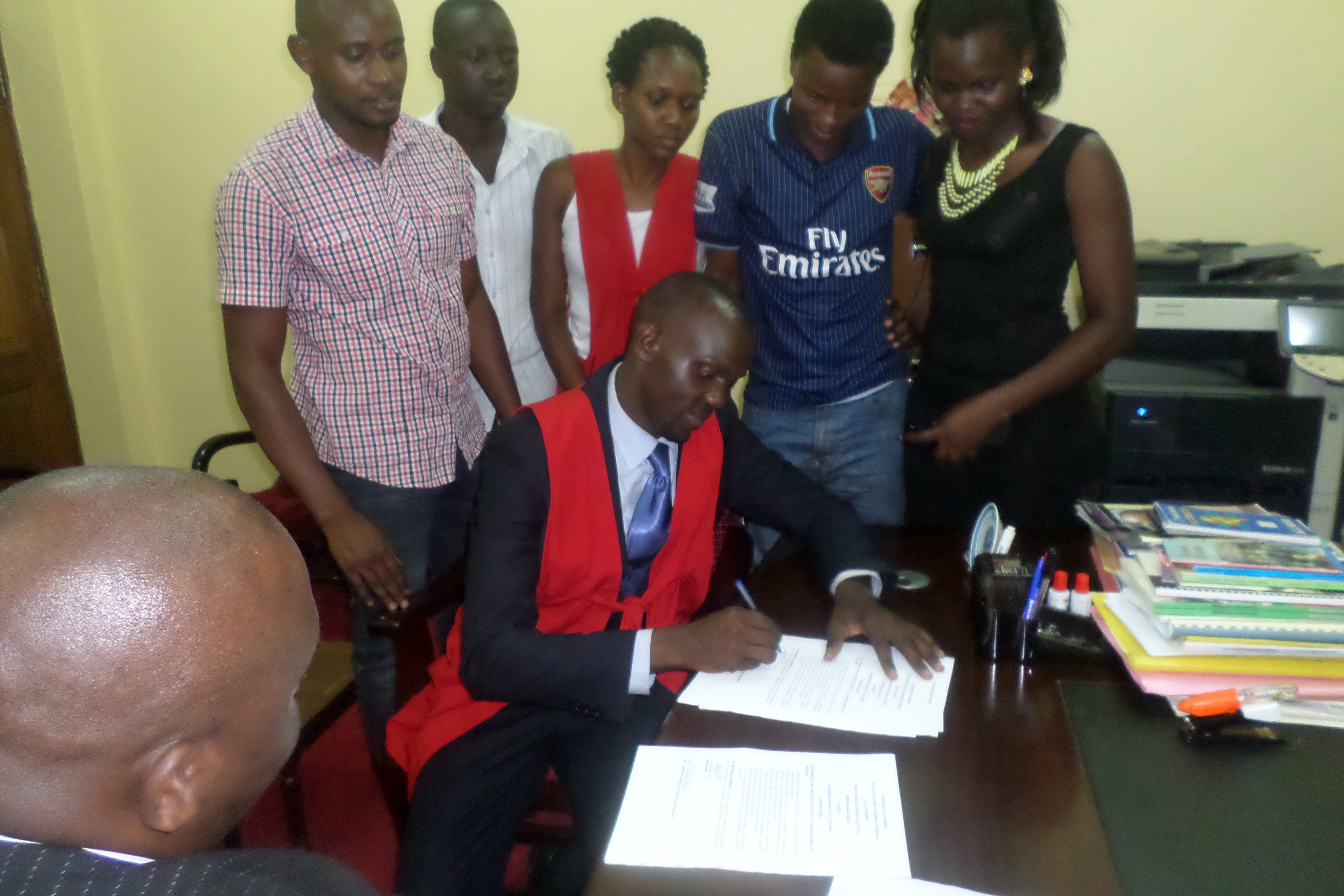 Bala David signs the consent form