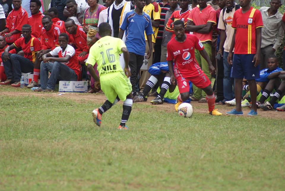 Munubi [in Red]  from MUK who won the man of the match game dribbling