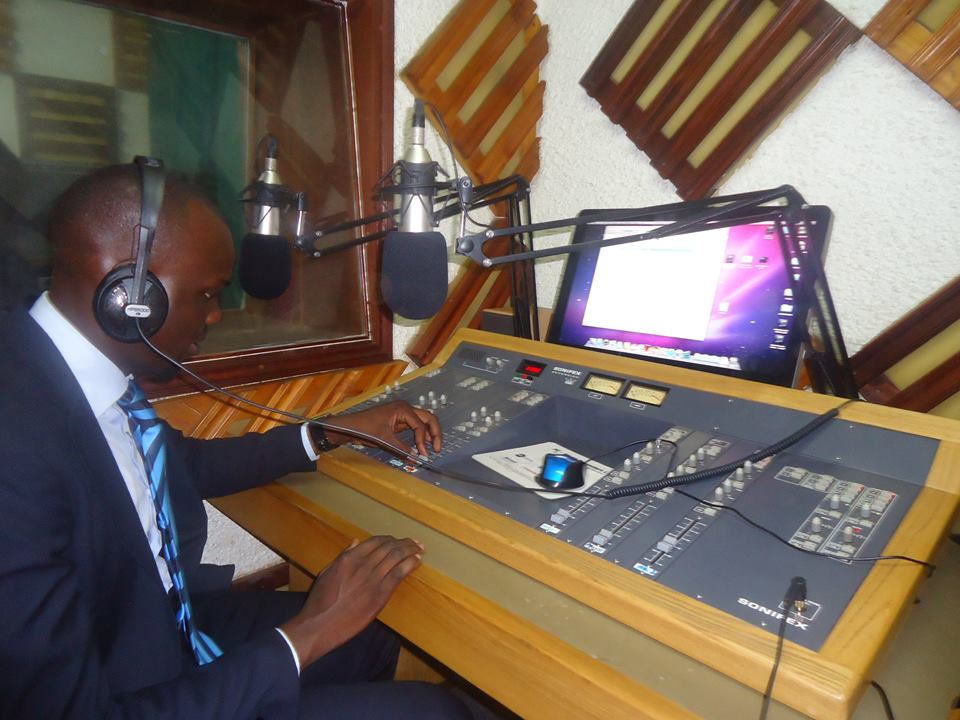 The guild President, Bala David, testing the signal in Campus FM studios at Makerere's Lincoln Flats