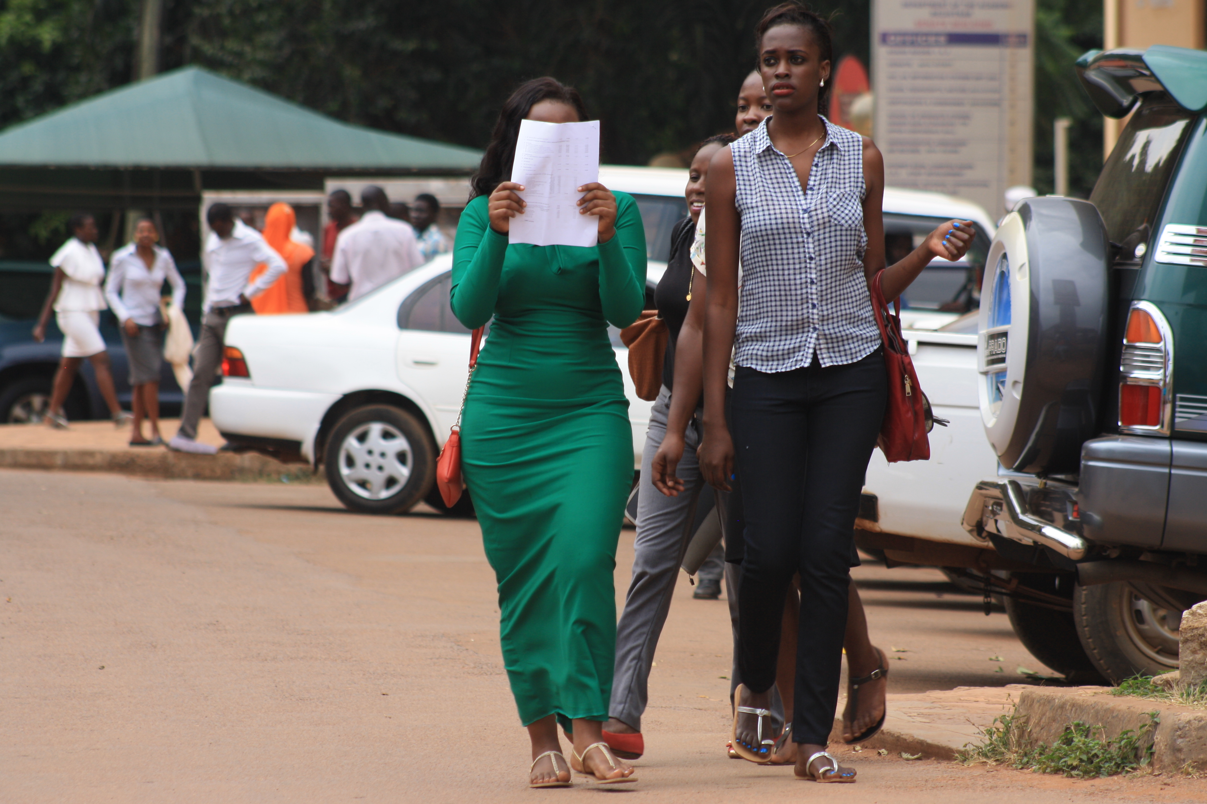 A couple strolls along the campus streets of Makerere| Photo by Zahra Abdul