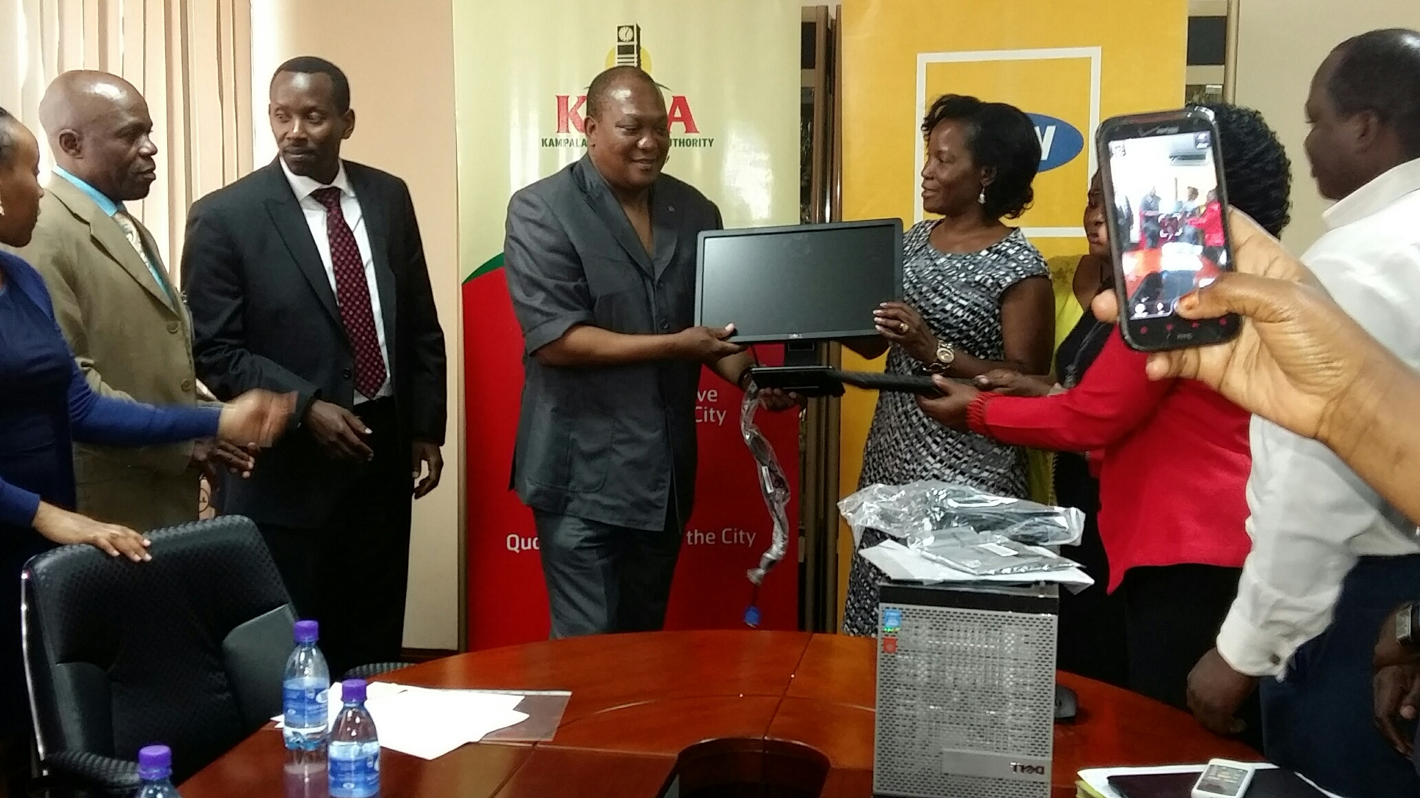 South African High Commissioner, also a trustee member of MTN Foundation, Prof. Maj. Gen (Rtd) L. S. Mollo ( L ) handing over the computers on Behalf of MTN Foundation to Executive Director of Kampala Capital City Authority, Ms. Jennifer Musisi (R ) at KCCA headquarters in Kampala.