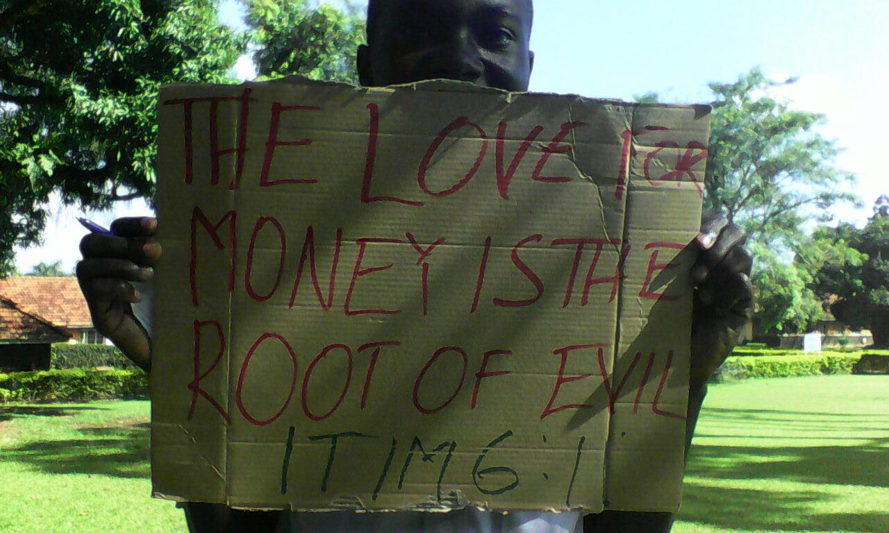 A UCU student in a peaceful demonstration