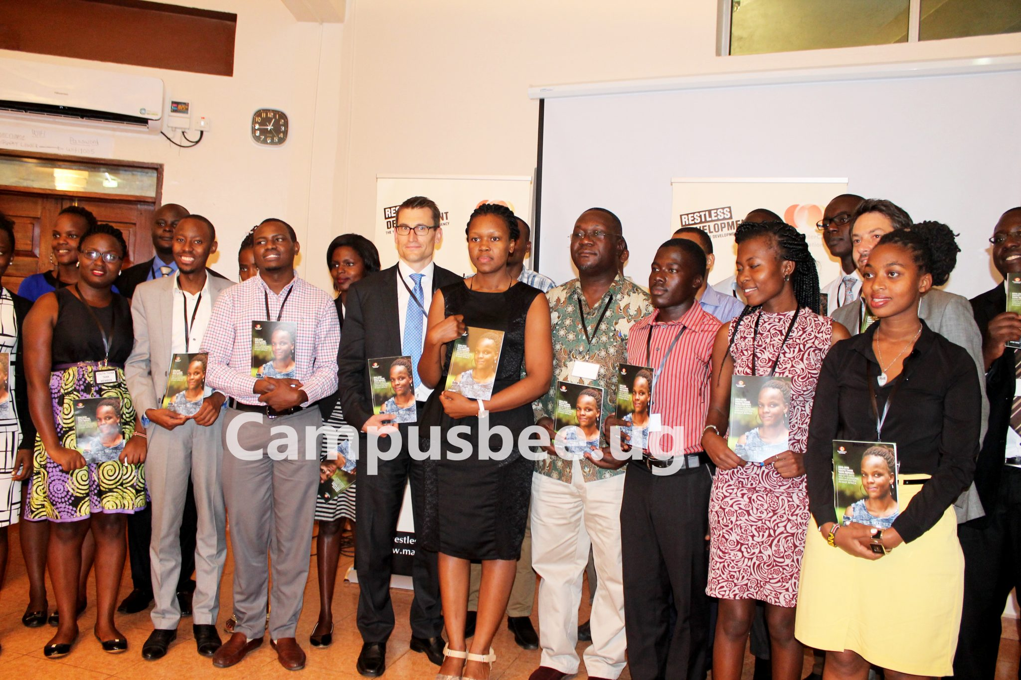 A group photo involving the Restless Development and MasterCard foundation members