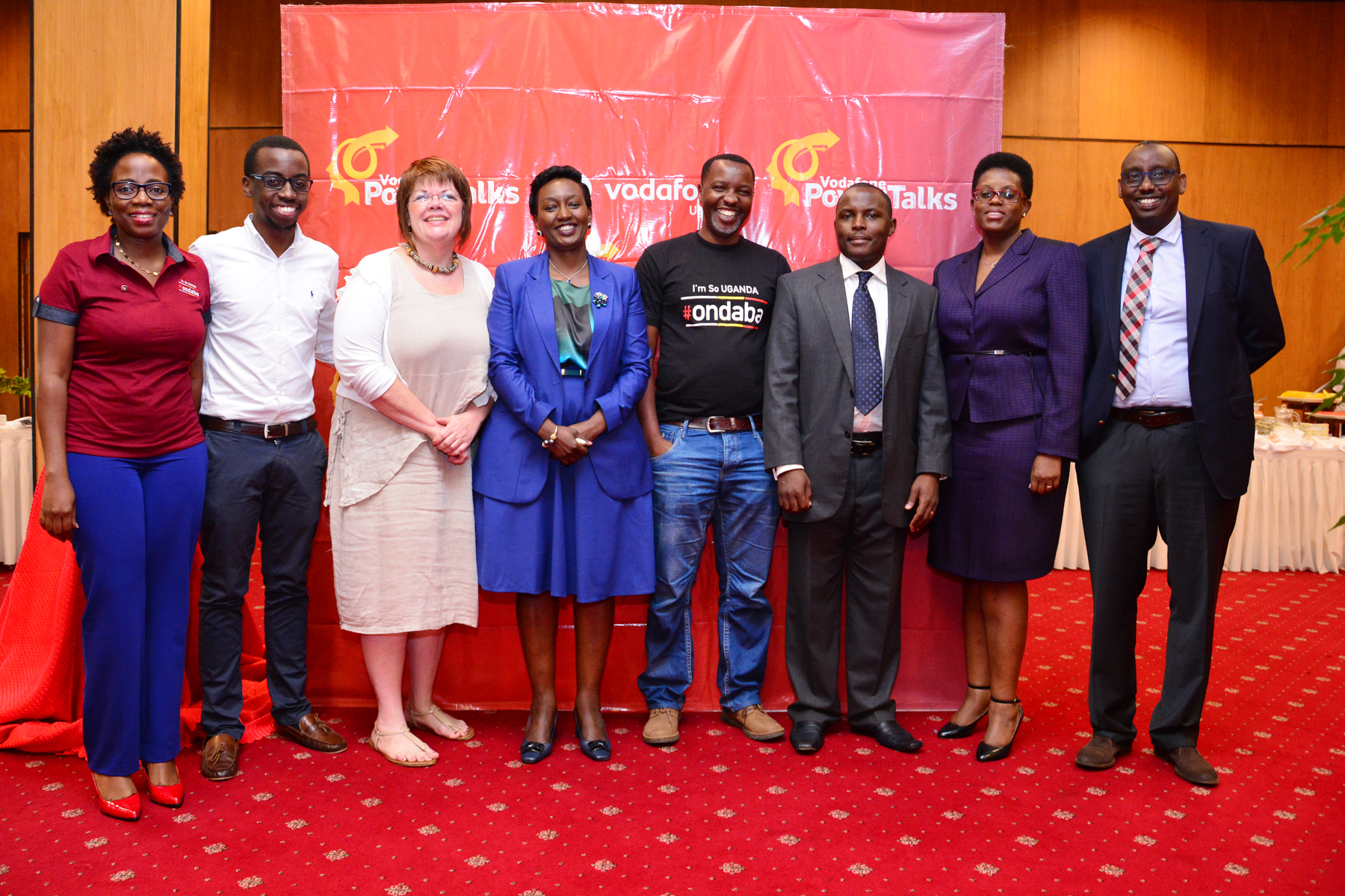Derrick Sebbaale, the Chief Technical Officer of Vodafone Uganda and the Vodafone Head of Marketing Jackie Namara poses for a photo with Steven Asiimwe , Amos Wekesa, Rosett Rugambwa, Kelly MacTavish, Phillip Kalibwami, Belinda Namutebi, the panellists of the 5th Vodafone Power Talks that was held on 28 July 2016 at Kampala Serena Hotel.