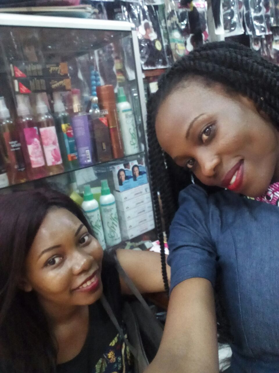 At her shop with a client