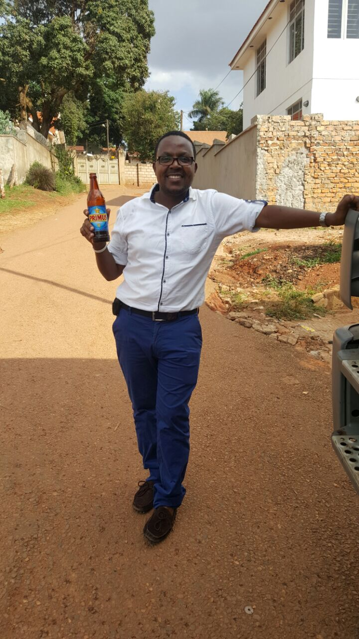 Steven Baryevugaheineken ugandas public relations lead displays their new Primus Lager