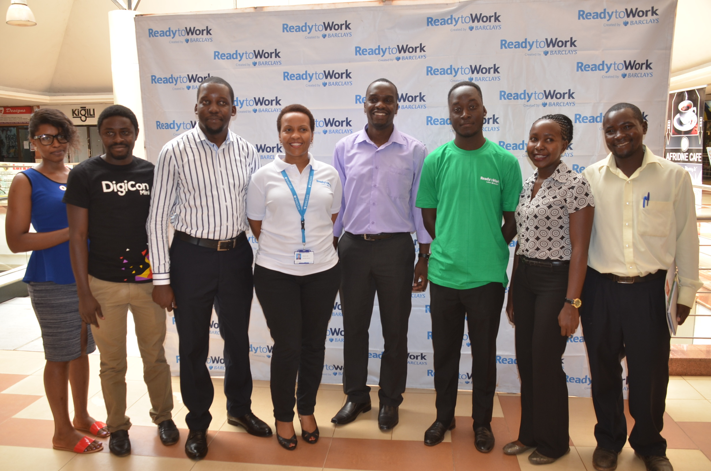 Juliana K. Lugayizi, Citizenship Manager, Marketing and Corporate Relations, Barclays Uganda (4L) pose for a photo with the ReadytoWork implementing partners and some of the beneficiaries during the ReadytoWork face-to-face free training that commenced yesterday December 5, 2016 at the Hub, Oasis Mall.