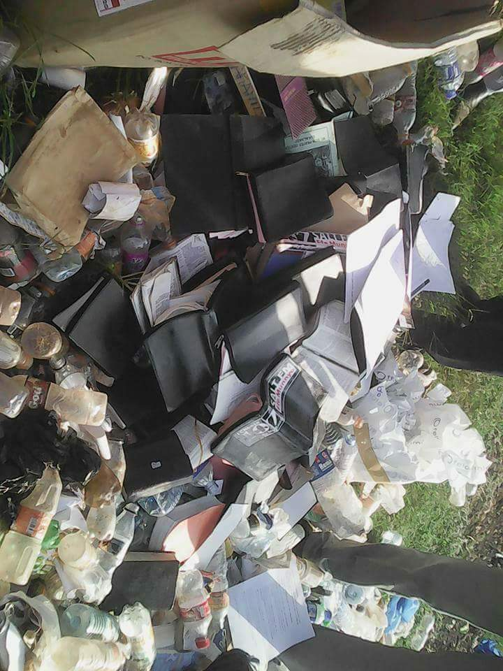 Image result for Pastor Aloysius Bujingo Burns Bibles