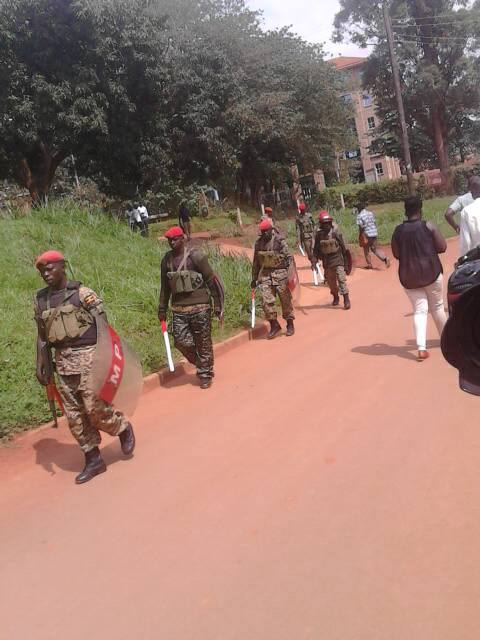 Military Police patrol Makerere.