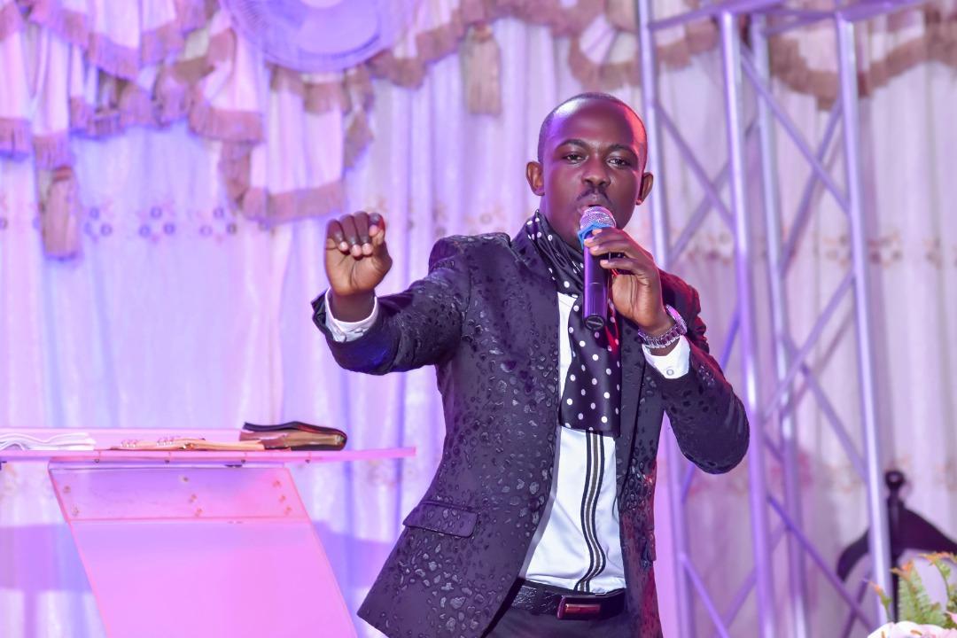 Pastor Kwesiga preaches