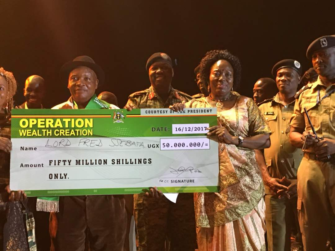 Rt Hon Rebecca Kadaga awards the grand prize to Lord Fred Ssebata | Photo by Arthur Musinguzi.
