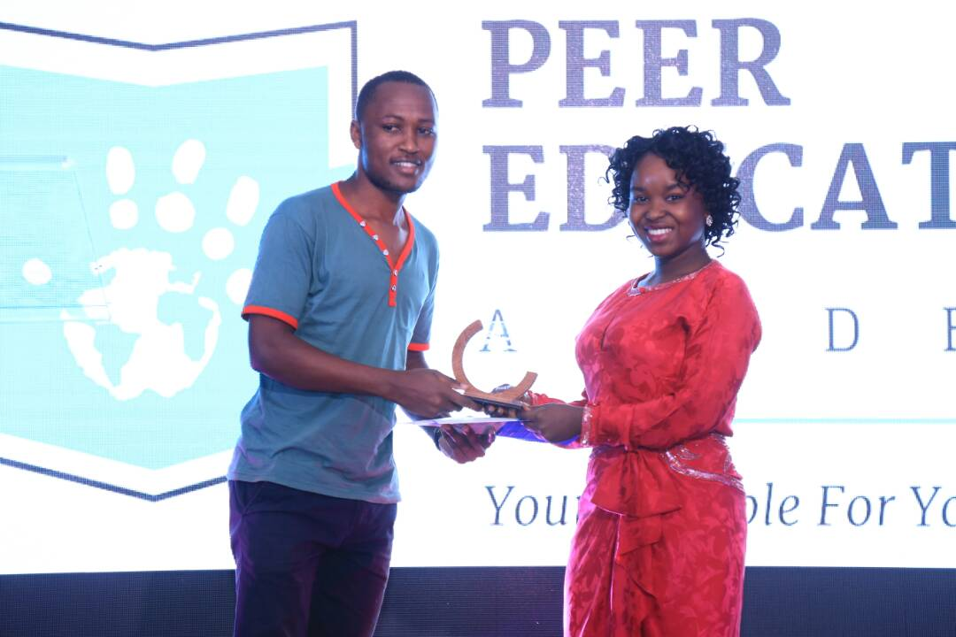 Frank Byaruhanga receiving the Best Social Media Award