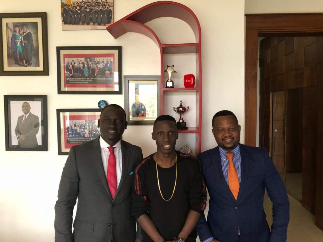 NEW SIGNING! Next Media CEO Kin Kariisa, Douglas Lwanga and Joe Kigozi unveil new signing.