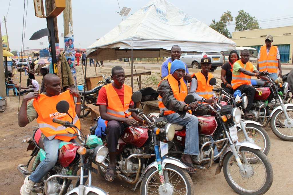 Fortebet aided bodaboda riders with reflector jackets in Arua - Fortebet Showers Arua, Nebbi, Pakwach And Koboko With Gifts
