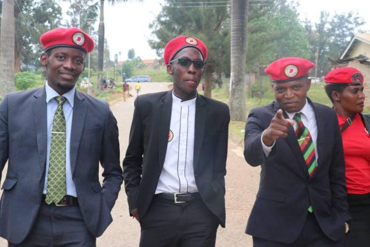 Julius Kateregga (right) the Makerere University Guild President