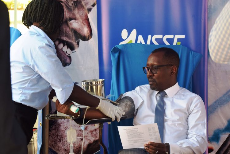 PHOTO CAPTION: NSSF Managing Director, Richard Byarugaba donates blood during the 2018 edition of the NSSF Blood Drive- the fund's social initiative that has raised 21,425 since 2012. This year, the fund aims to raise at least 15,000 units so as to end the cyclic blood shortage in the December-January period.