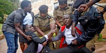 A Makerere University student during an earlier protest (FILE PHOTO)